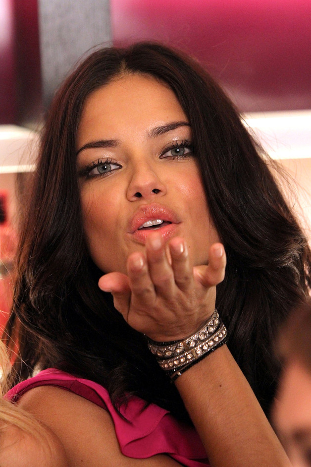 Adriana Lima Blows a Kiss