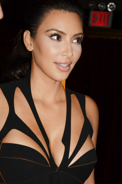 http://assets.thehollywoodgossip.com/photos/xlarge_p/kim-kardashian-cleavage-dress.jpg